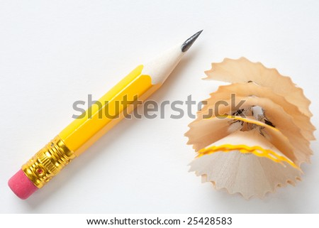 Very short yellow pencil with shavings on textured white paper - stock photo