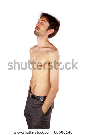very skinny guy flexing his muscles - stock photo