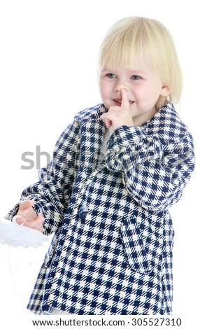 Very small blonde girl in a plaid fall coat picks his nose, close-up-Isolated on white background - stock photo