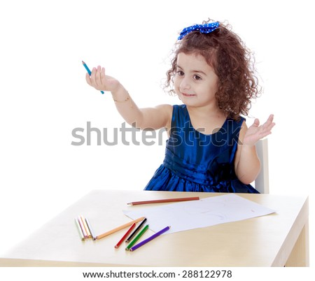 Very smart little girl draws with pencils sitting at the table-isolated on white background