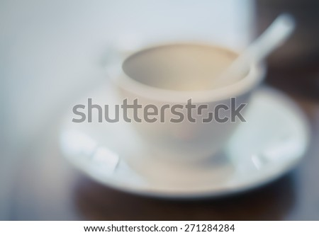 very soft defocus  focus and blur empty  abstract white single, only one alone coffee cup close up blur Cappuccino or latte coffee of vintage tone style background,  - stock photo