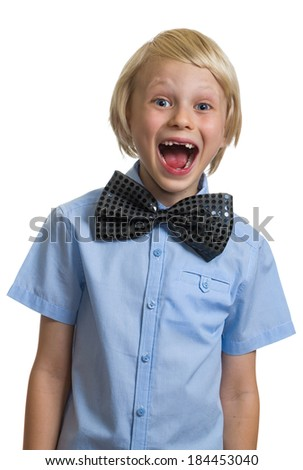 Very surprised boy in big black bow tie isolated on white background - stock photo