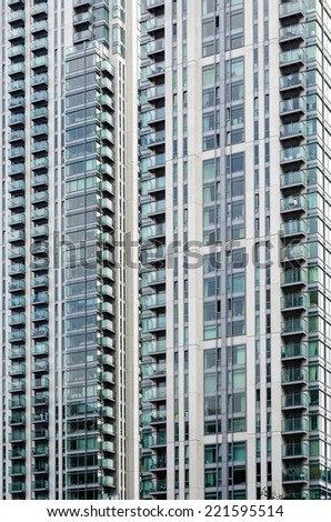 Very tall residential building with lots of balconies - stock photo