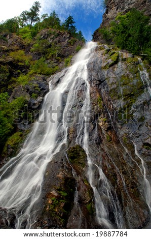 Very tall waterfall cascading over a rocky landscape