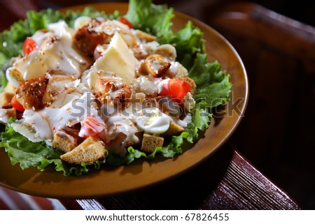 Very tasty and appetizing salad with chicken meat quail eggs and toasts.