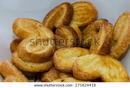 Very tasty cakes in the plate on the kitchen - stock photo