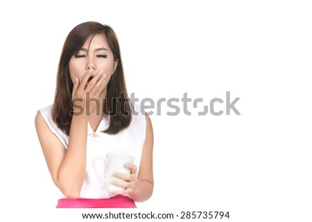 Very tired looking asian woman and holding cup coffee with blank copyspace,Closeup portrait of beautiful Asian woman,Thai girl,Negative human emotion facial expression,isolated on white background - stock photo