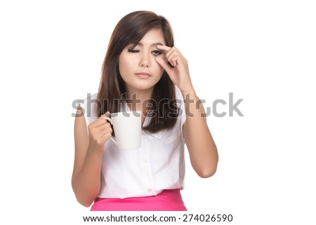 Very tired looking woman and holding cup coffee, keeping eyes opened,Closeup portrait of beautiful Asian woman,Thai girl,Negative human emotion facial expression,isolated on white background - stock photo