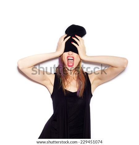 Very upset and emotional woman over white background, not isolated - stock photo