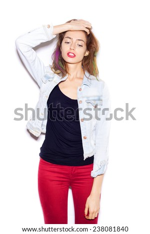 Very upset and emotional woman over white background, not isolated.  - stock photo