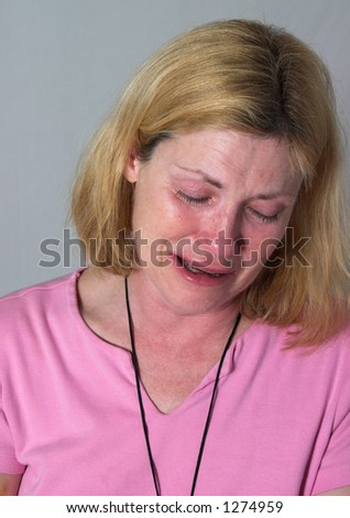 very upset, grieving woman crying real tears - stock photo