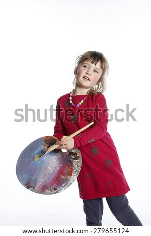 very young girl in red with brush and palette for painting in studio against white background - stock photo