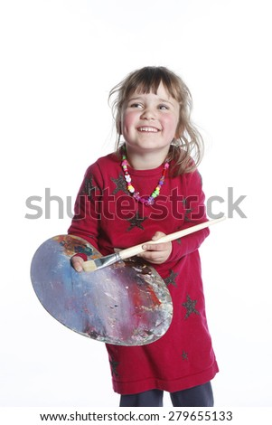 very young girl in red with brush and palette for painting in studio against white background