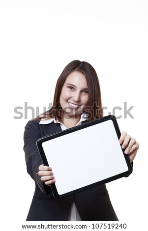 very young looking woman in a suit holding out a blank white board