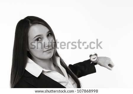 very young looking woman in a suit holding up her watch - stock photo