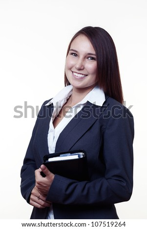 very young looking woman in a suit just starting out trying to do well in business holding a filo fax ready for work