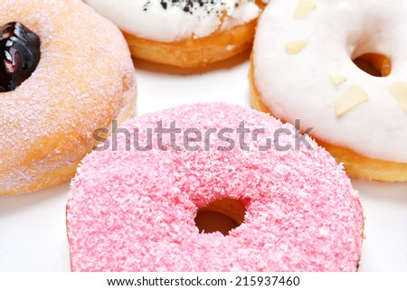 Very yummy and delicious doughnuts in the white box. - stock photo