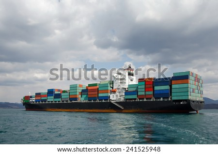 Vessel standing near port on an anchor - stock photo