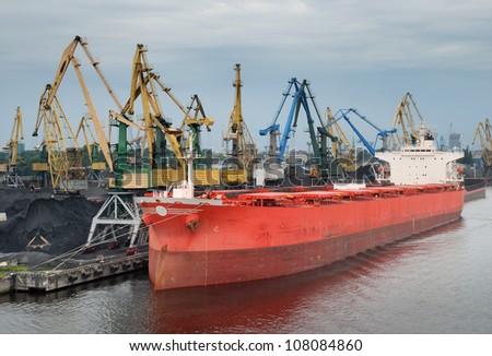 Vessel under loading in Riga port, Latvia. - stock photo
