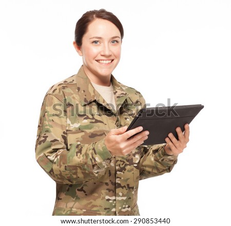Veteran Soldier | Attractive female soldier with digital tablet wearing multicam camouflage. - stock photo