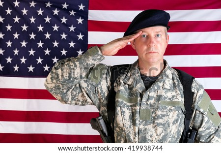 Veteran soldier, facing forward, saluting with USA flag in background. Soldier armed with military pistol and ammo clips.