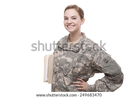 VETERAN SOLDIER   Female Army sergeant holding file with hand on hips, going back to school with her GI Bill Education Benefits - stock photo