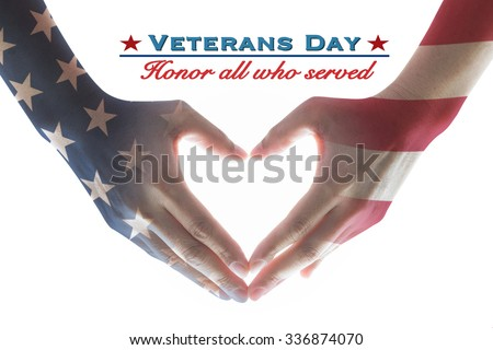 Veterans day holiday celebration concept: American flag pattern on human hands in heart sign shape with text message honor all who served for brave military on white background: President's day - stock photo