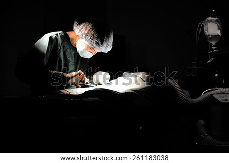 veterinarian doctor in operation room for surgical,selective color technique - stock photo