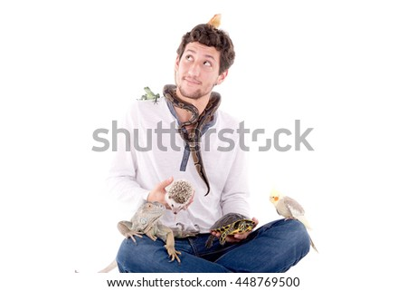veterinarian posing with wild exotic animals