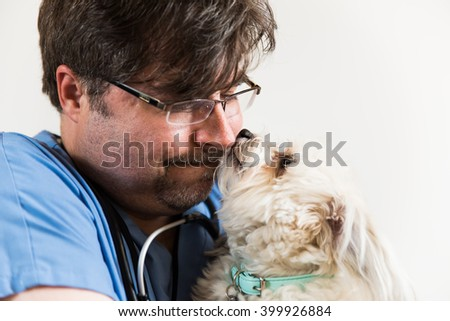 Veterinarian with cute white dog.