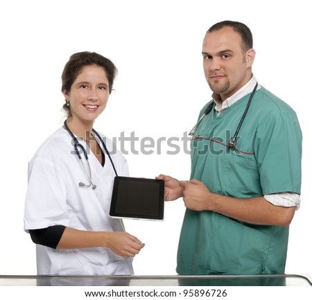 Vets holding a digital tablet - stock photo