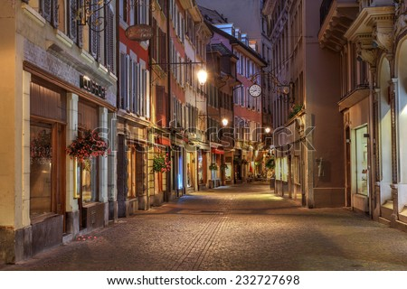VEVEY, SWITZERLAND - OCTOBER 2: Pedestrian street (Rue du Lac) in the old town of Vevey on the shore of Lake Leman (Lake Geneva) in Switzerland on a quiet week evening of October 2, 2014. - stock photo