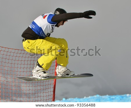 VEYSONNAZ, SWITZERLAND - JANUARY 21: Finalist Sven Aschwanden (SWE) competes at the  FIS World Championship Snowboard Cross finals on January 21, 2012 in Veysonnaz, Switzerland