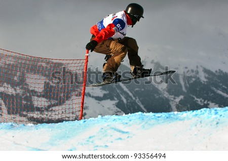 VEYSONNAZ, SWITZERLAND - JANUARY 21: Finalist Tamoyoshi Harada (JPN) competes at the  FIS World Championship Snowboard Cross finals on January 21, 2012 in Veysonnaz, Switzerland