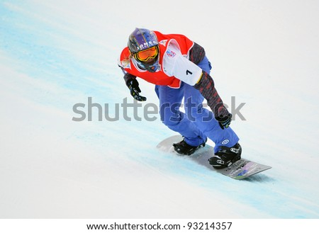 VEYSONNAZ, SWITZERLAND - JANUARY 19: World Champion Lindsay Jacobellis in the FIS World Championship Snowboard Cross finals : January 19, 2012 in Veysonnaz Switzerland - stock photo