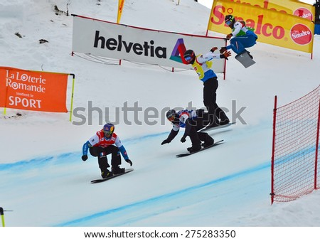 VEYSONNAZ, SWITZERLAND - MARCH 14:  Pierre VAULTIER (FRA) leads the pack in the finals of the Snowboard Cross World Cup: March 14, 2015 in Veysonnaz, Switzerland - stock photo