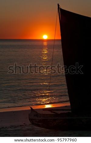 Vezo dugout at sunset near Tsifota, southwestern Madagascar - stock photo