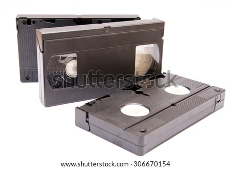 VHS tapes isolated on white, selective focus on tape in the middle  - stock photo