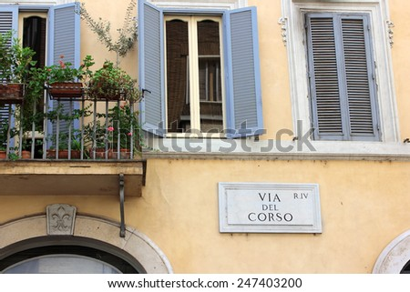 Via del Corso, street plate on a wall of old house in Rome, Via del Corso, main shopping street of Rome, Italy - stock photo