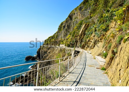 Via dell Amore, The Way of Love, famous pedestrian street linking Manarola and Riomaggiore. Cinque Terre National Park, Liguria Italy Europe. - stock photo