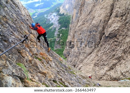 "Via ferrata ""Brigata Tridentina"" takes climber on steep walls high above the ground, Sella massif, Dolomite Alps, Italy"