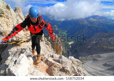 Via ferrata climbing in sunny day, Dolomite Alps, Italy