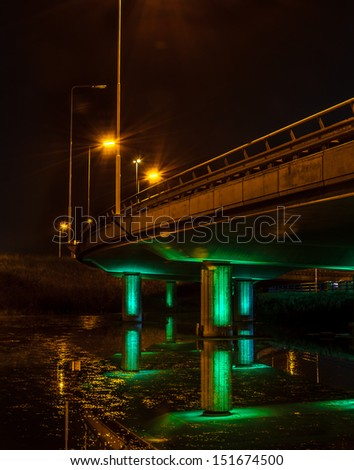 Viaduct under green lights - stock photo