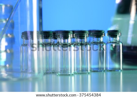 Vial in laboratory under blue light