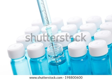 Vial with vaccine and syringe - stock photo