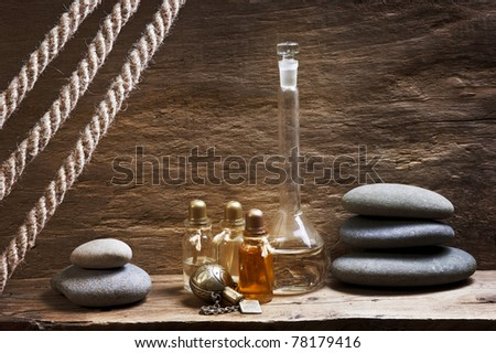 Vials with essential oils against the old wooden walls - stock photo