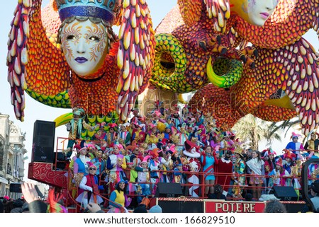 VIAREGGIO, ITALY - FEB 16: Festival, the parade of carnival floats with dancing people on streets of Viareggio, February 16, 2013 in Viareggio,Italy. - stock photo