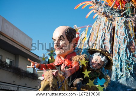 VIAREGGIO, ITALY - FEB 16: Festival, the parade of carnival floats with dancing people on streets of Viareggio, February 16, 2013 in Viareggio,Italy.