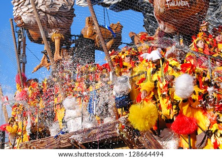 VIAREGGIO, ITALY - 10 FEBRUARY 2013 : Festival,the parade of carnival floats with dancer on streets of Viareggio, February 10, 2013 in Viareggio,Italy - stock photo