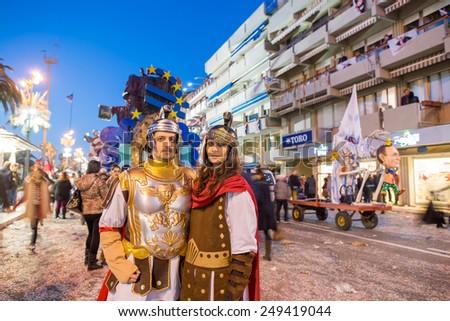 VIAREGGIO, ITALY - FEBRUARY 23, 2014 : Festival, the parade of carnival floats with dancing people on streets of Viareggio, Italy. - stock photo